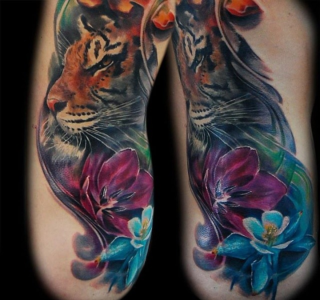 Spectacular realism style tattoo of realistic tiger with flowers