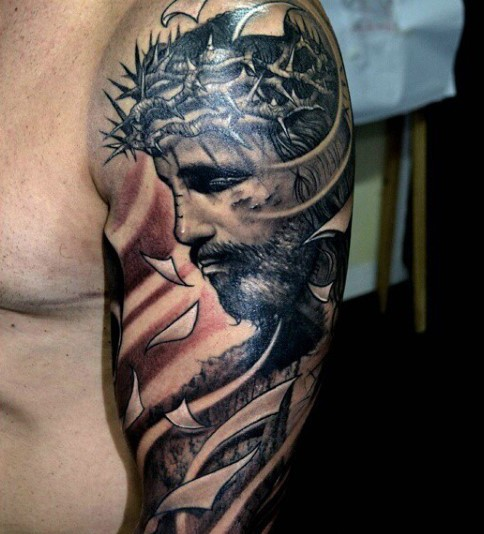 Spectacular religious style colored shoulder tattoo of dramatic Jesus portrait