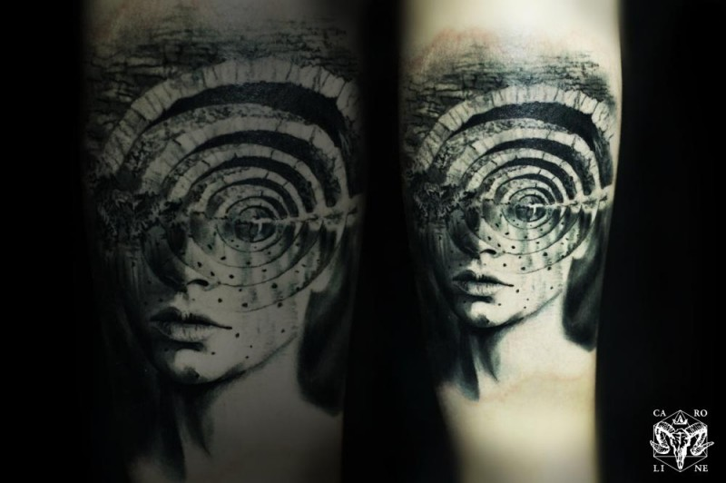 Spectacular surrealism style black ink forearm tattoo of human face with mystic ornament