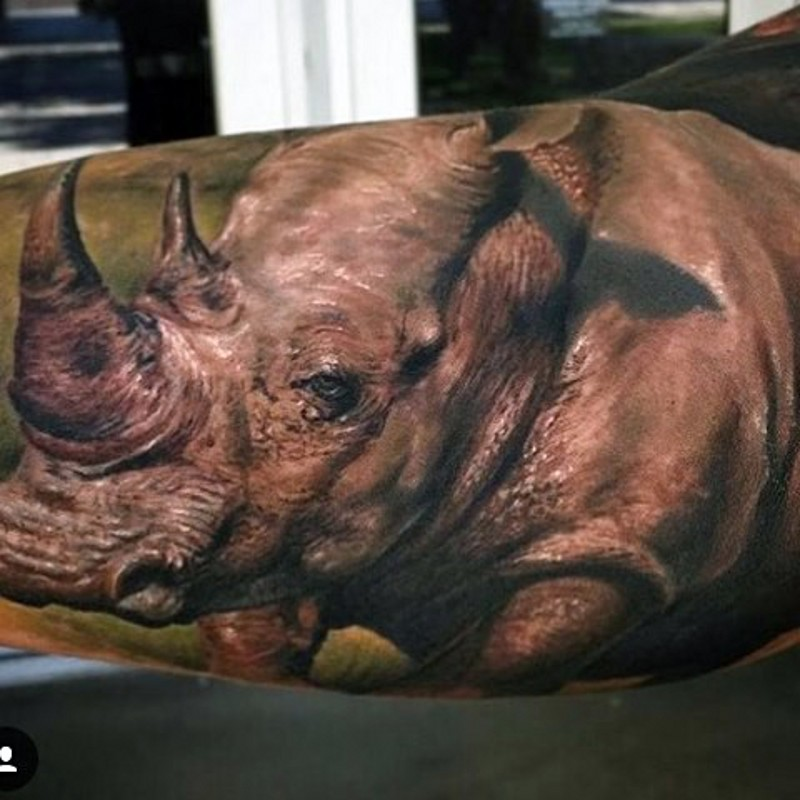 Spectacular very detailed colorful arm tattoo of massive natural rhino
