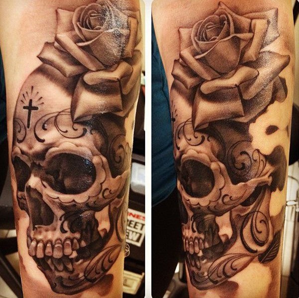 Spectacular very detailed realism style black and white arm tattoo fo human skull and beautiful rose flower