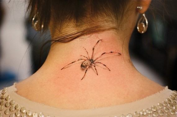 Spider tattoo on neck for girls