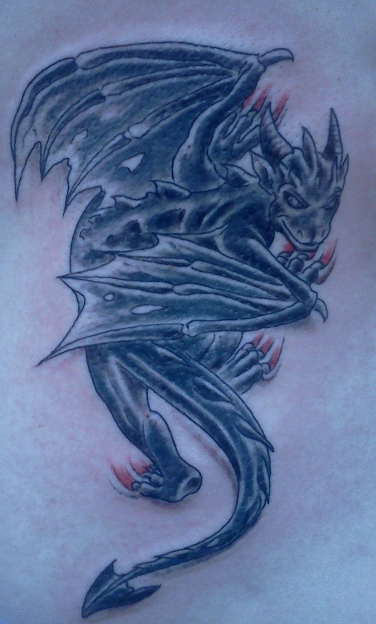 Spooky creeping up gargoyle tattoo