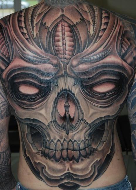 Spooky great skull tattoo on whole back