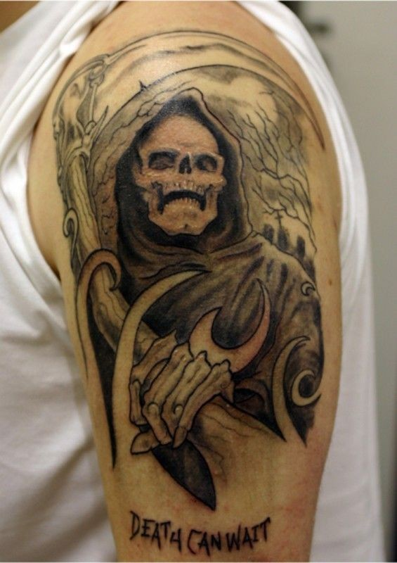 Spooky grim reaper tattoo on half sleeve