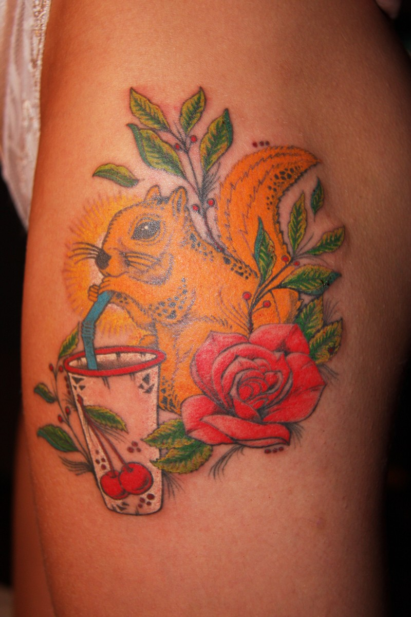 Squirrel tattoo drinking coctail with flowers