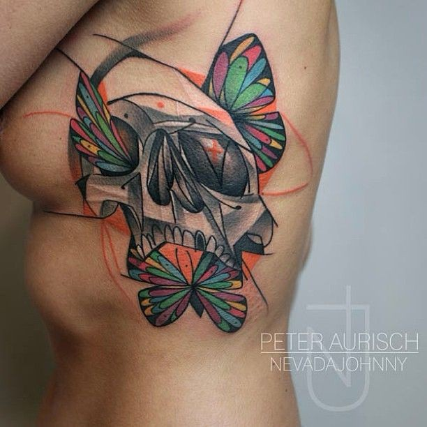 Skull and colored butterfly tattoo