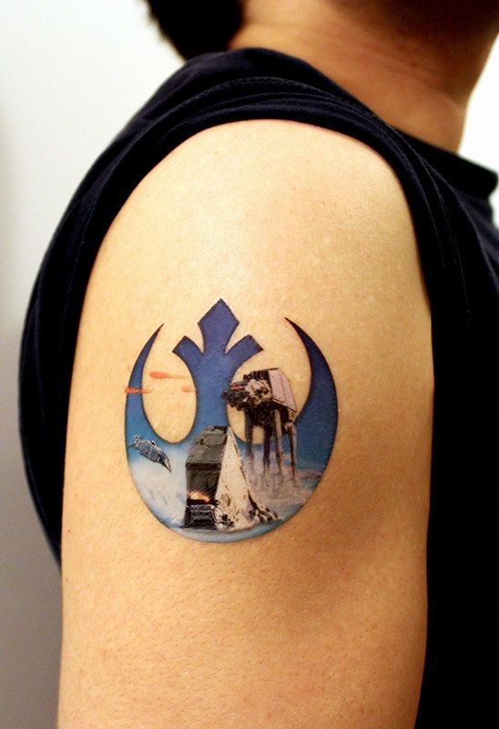 Star Wars Rebel symbol decorated with film scenes colored shoulder tattoo