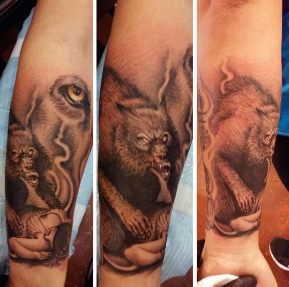 Stippling style black and white forearm tattoo of demonic werewolf