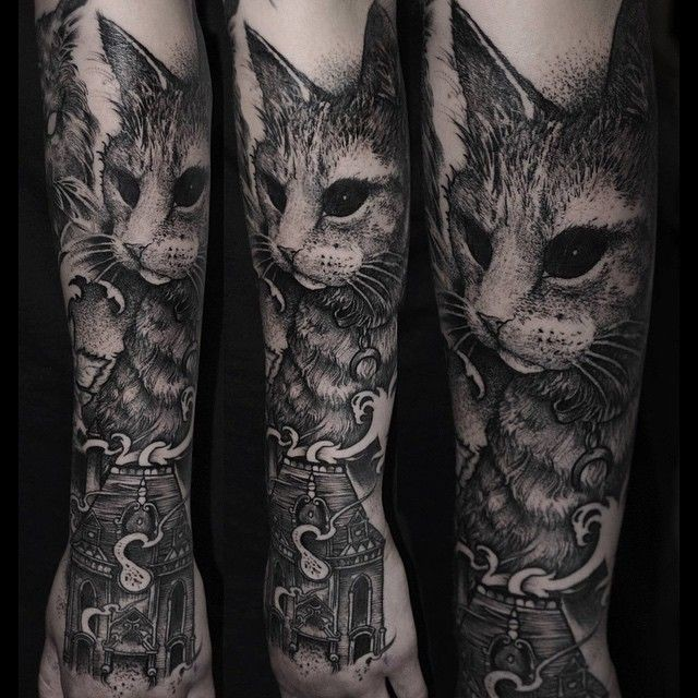 Stippling style black and white forearm tattoo of cool looking cat