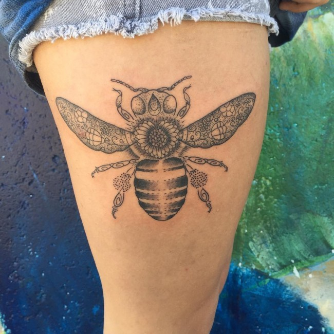 Stippling style black and white thigh tattoo of bee