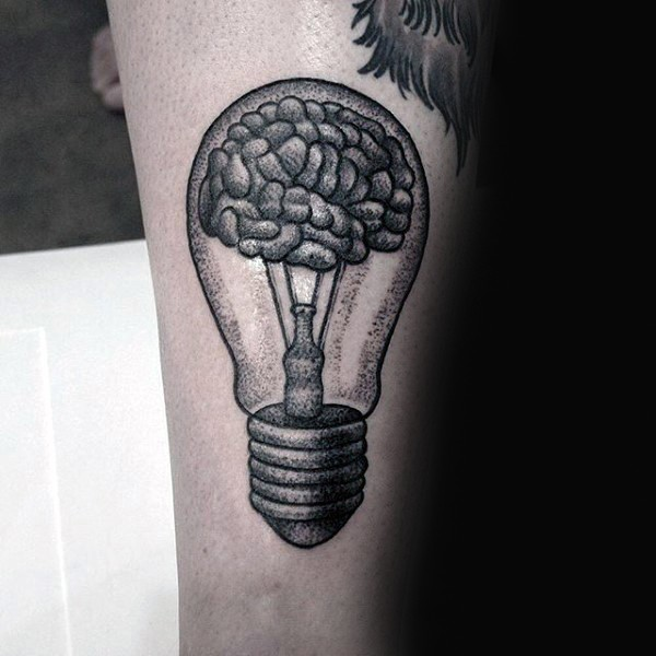 Stippling style black ink arm tattoo of bulb with human brain