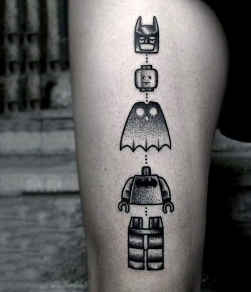 Stippling style black ink arm tattoo of Lego Batman