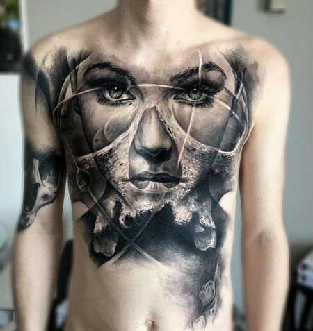 Stippling style black ink chest tattoo of woman with skull