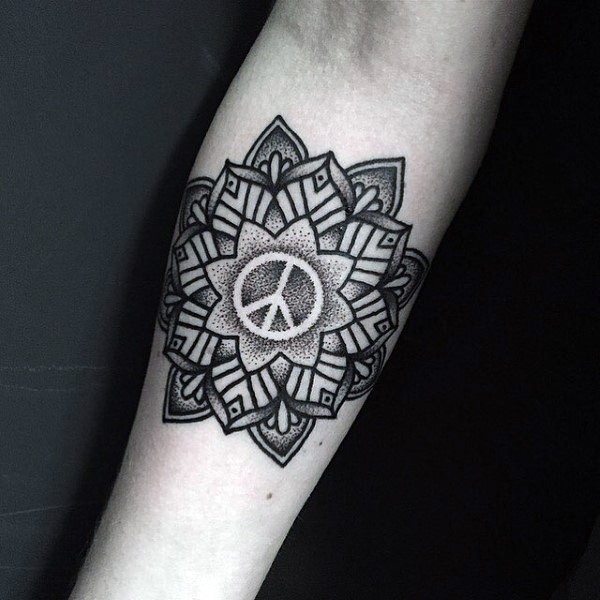 Stippling style black ink forearm tattoo of large flower