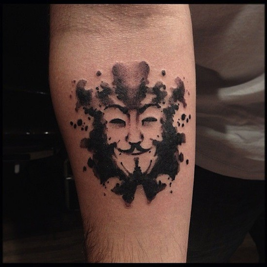 Stippling style black ink forearm tattoo of funny mask