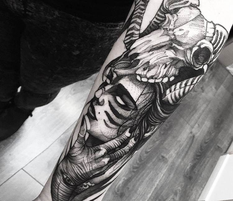Stippling style black ink forearm tattoo of woman with animal skull