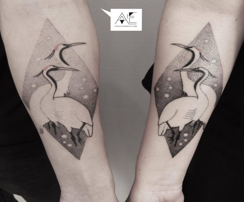 Stippling style black ink forearm tattoo of birds