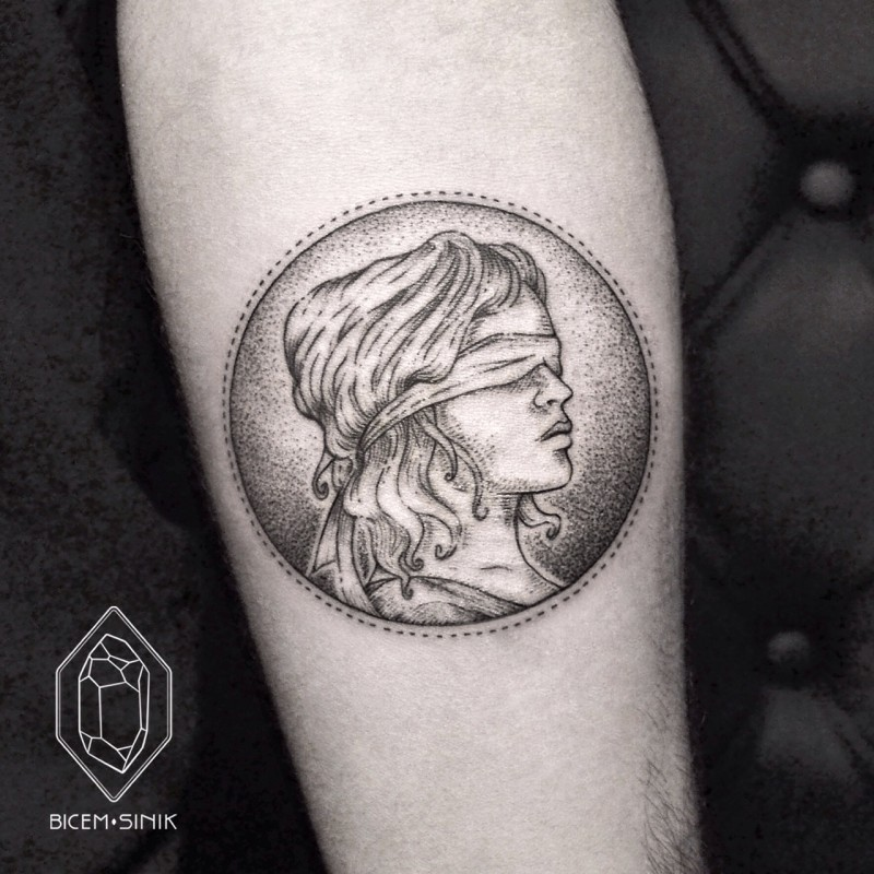 Stippling style black ink forearm tattoo of coin with bling woman