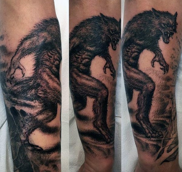 Stippling style black ink forearm tattoo of evil werewolf