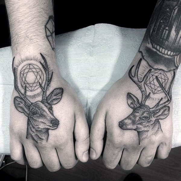 Stippling style black ink hands tattoo of mystical deers with various ornaments