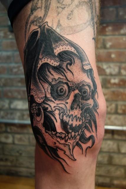 Stippling style black ink leg tattoo of creep skeleton