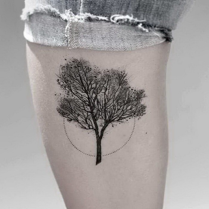 Stippling style black ink leg tattoo of small tree