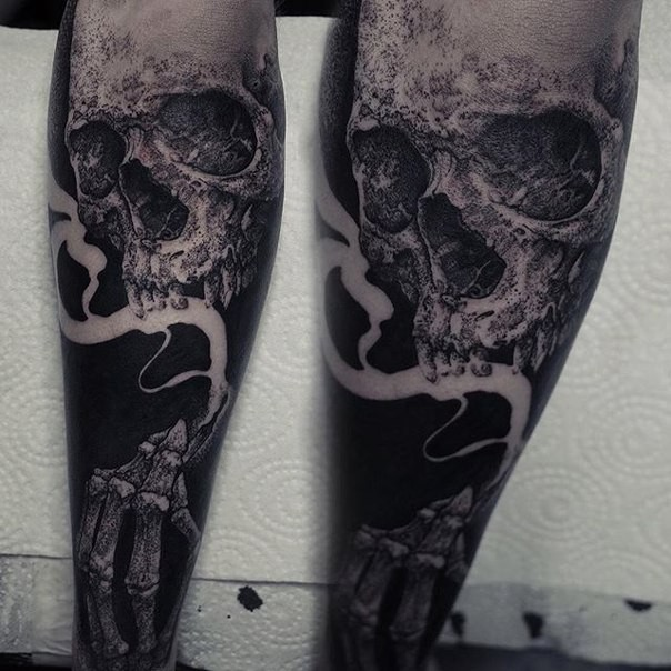 Stippling style black ink leg tattoo of human skeleton with fog