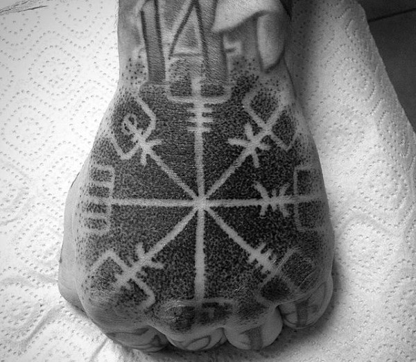Stippling style black ink mystical ornament tattoo on fist