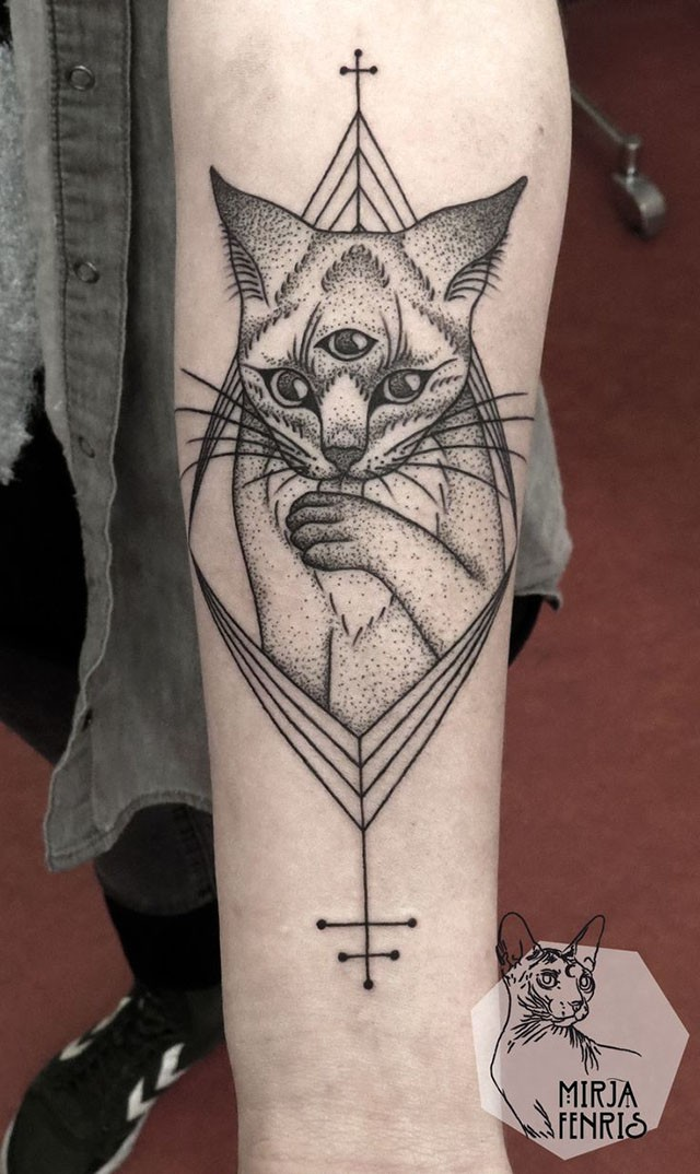 Stippling style black ink shoulder tattoo of mysterious cat with cross