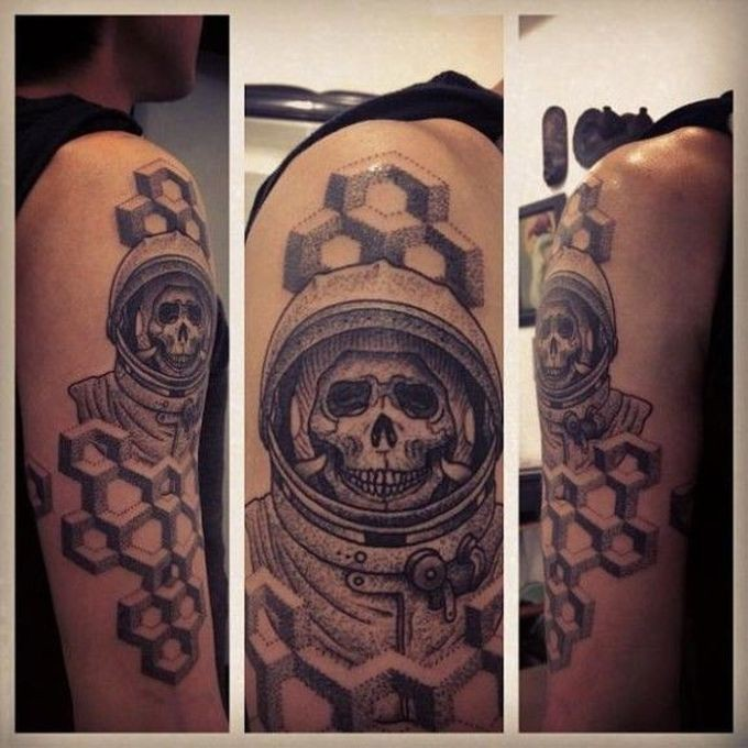 Stippling style black ink shoulder tattoo of astronaut skeleton