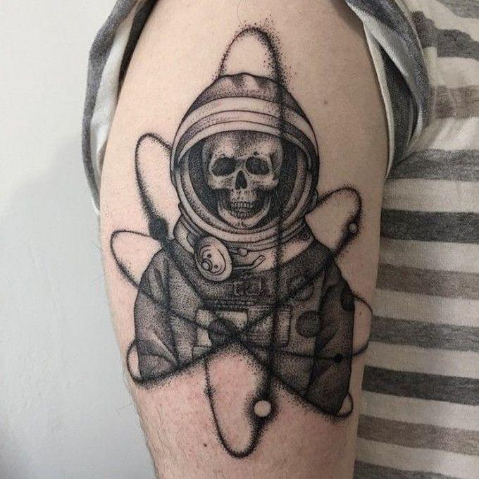 Stippling style black ink shoulder tattoo of big astronaut skeleton