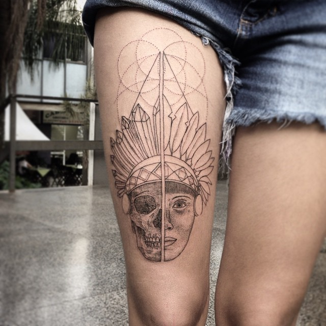 Stippling style black ink thigh tattoo of Indian face with geometrical ornaments