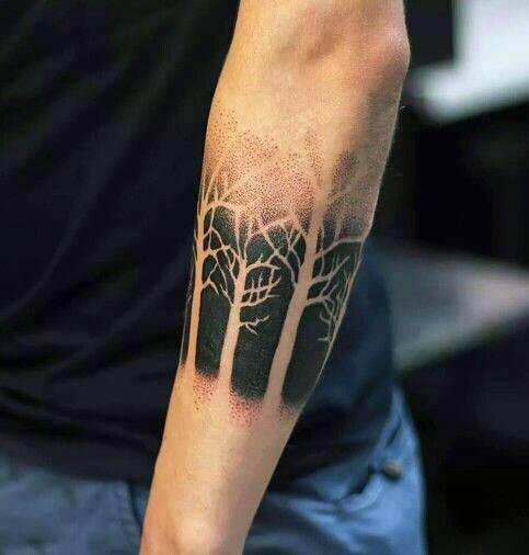 Stippling style black ink typical forearm tattoo of forest