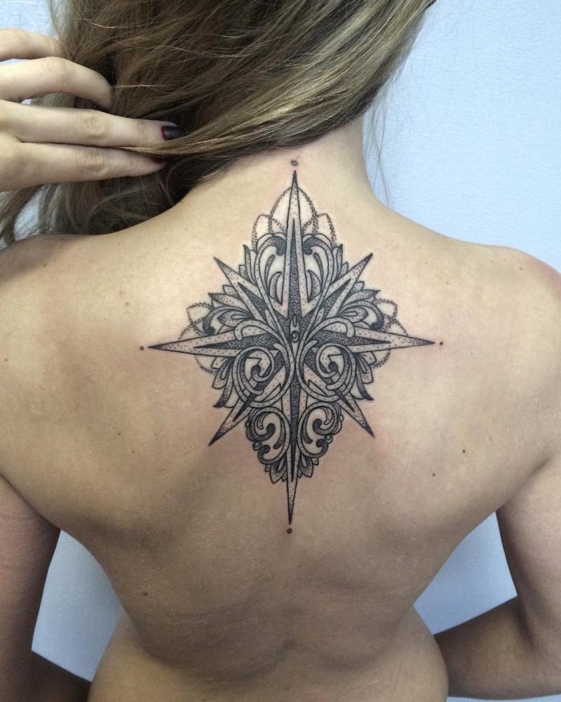 Stippling style black ink upper back tattoo of star