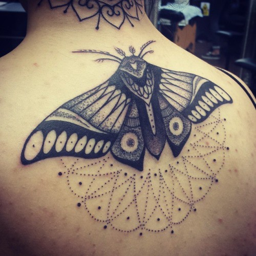 Stippling style black ink upper back tattoo of butterfly