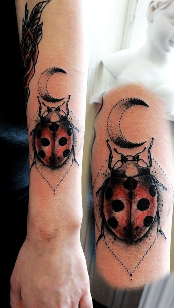 Stippling style colored forearm tattoo of lady bug with moon