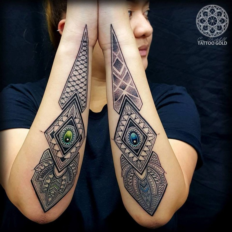 Stippling style colored forearm tattoo of interesting ornament with diamonds