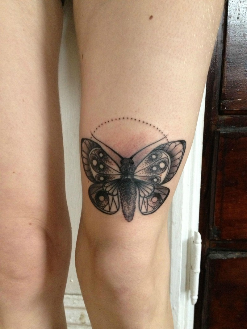 Stippling style colored leg tattoo of butterfly
