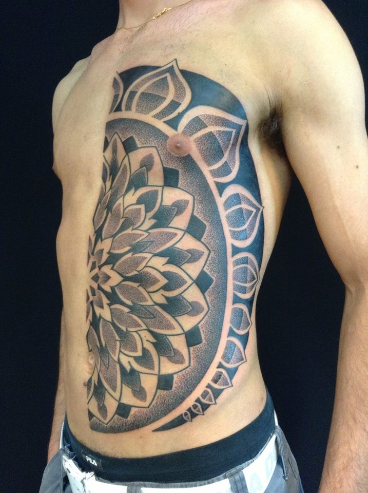Stippling style half chest and belly tattoo of big flower