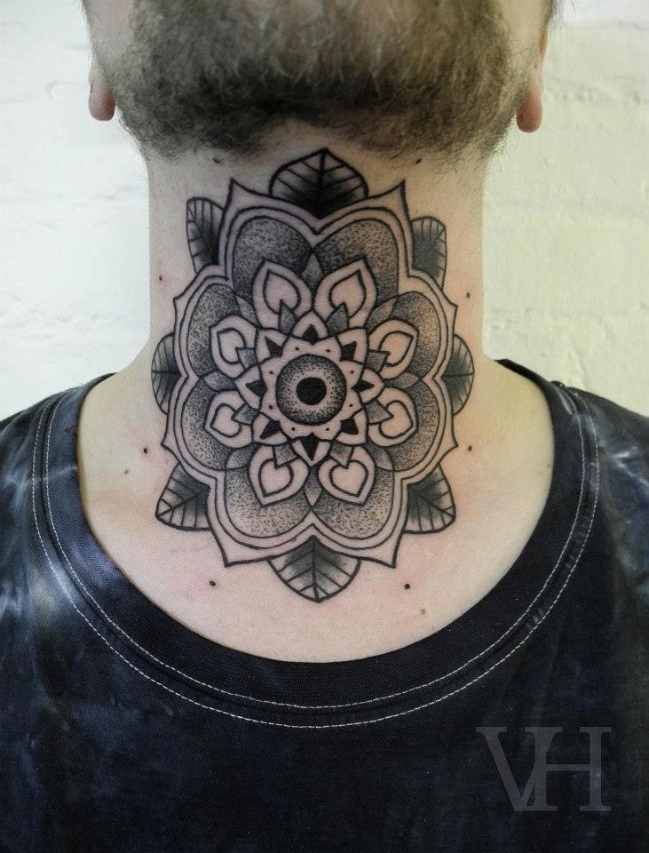 Stippling style large black ink throat tattoo of flower