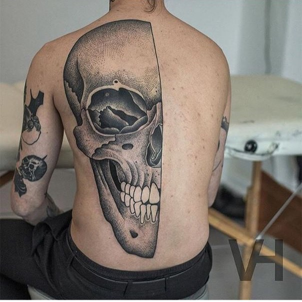 Stippling style large human skull tattoo on half back