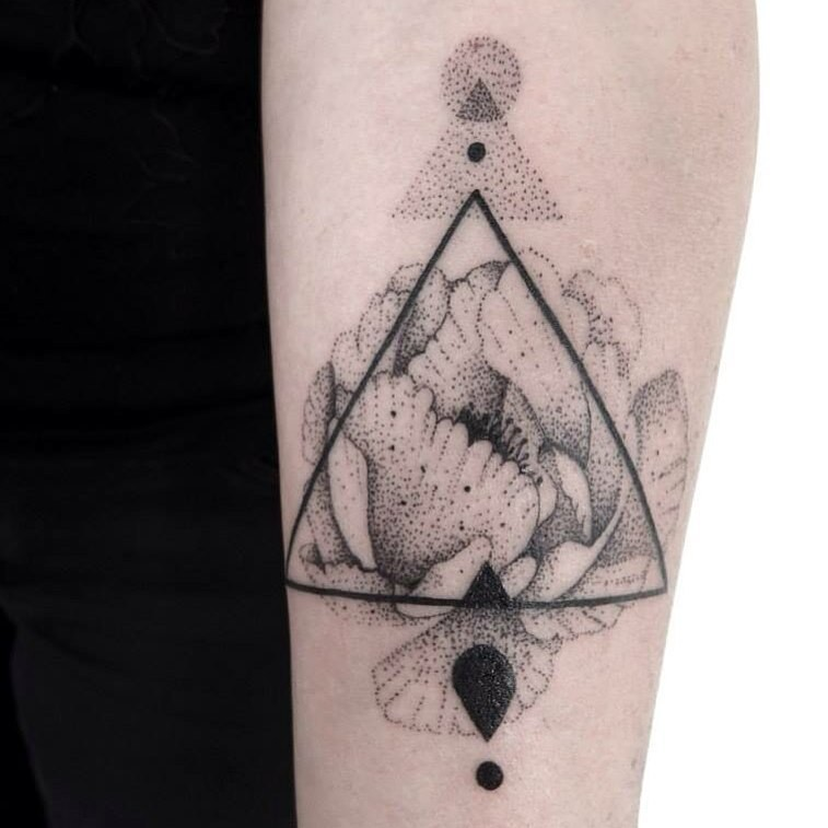 Stippling style simple forearm tattoo of flower with triangle