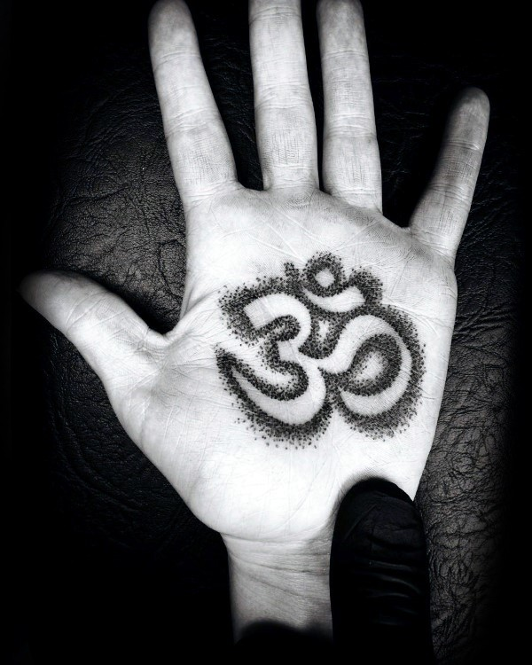Stippling style small hand tattoo of Hinduism symbol