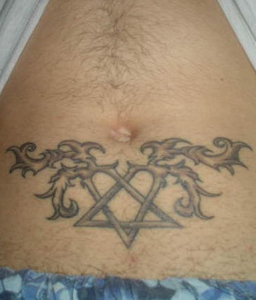 Stomach tattoo, two curled pins crossed, gray image