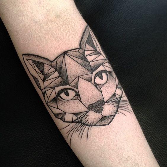 Stone like black ink forearm tattoo of dot style cat head