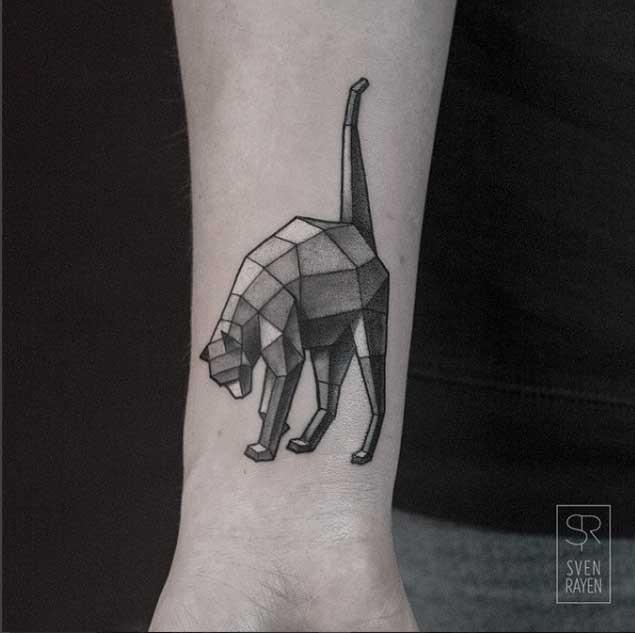 Stone like black ink wrist tattoo of typical cat