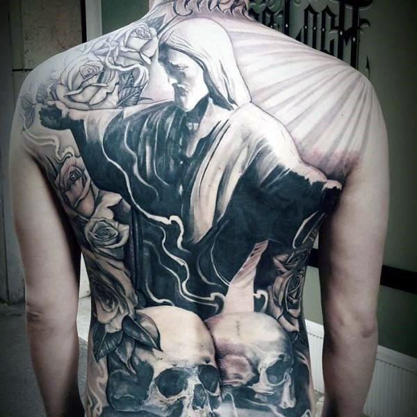 Stonework style black and white whole back tattoo of big statue with skulls