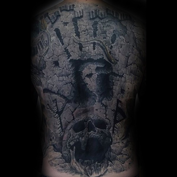 Stonework style black ink back tattoo of big wall with human skull