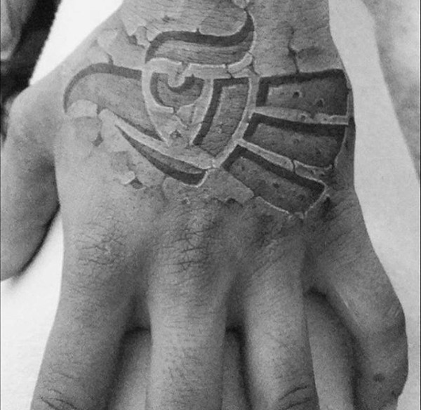 Stonework style black ink hand tattoo of incredible ornament